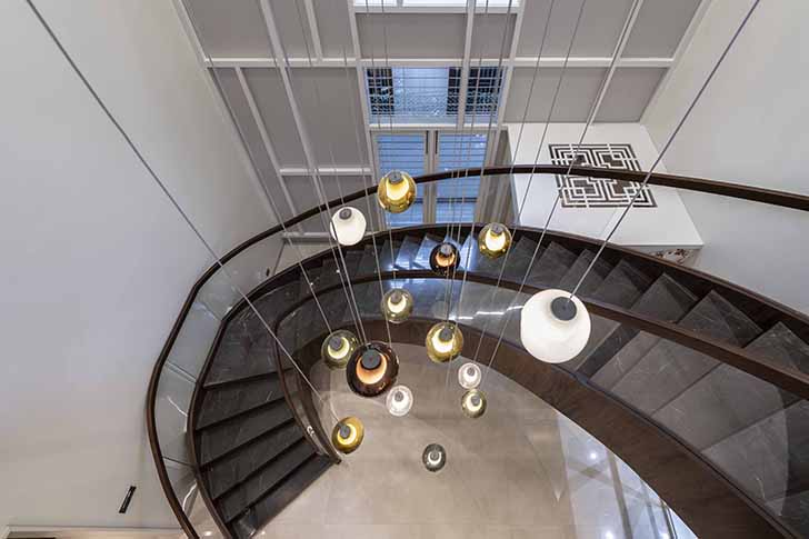 curved staircase Chennai residence HSDesiigns indiaartndesign